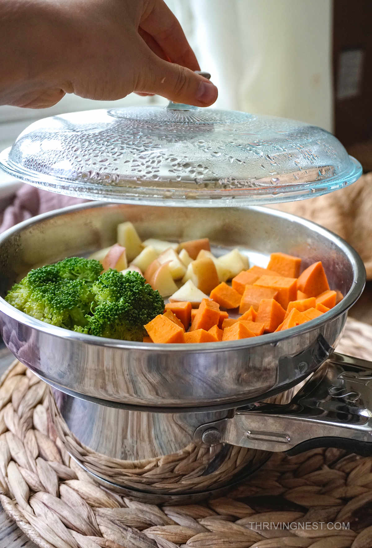 Steaming broccoli, sweet potato and apple for baby food.