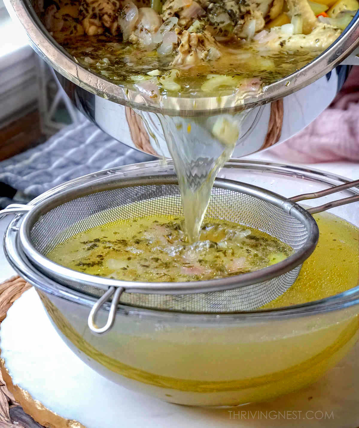 Baby stock or baby broth strained through a sieve.