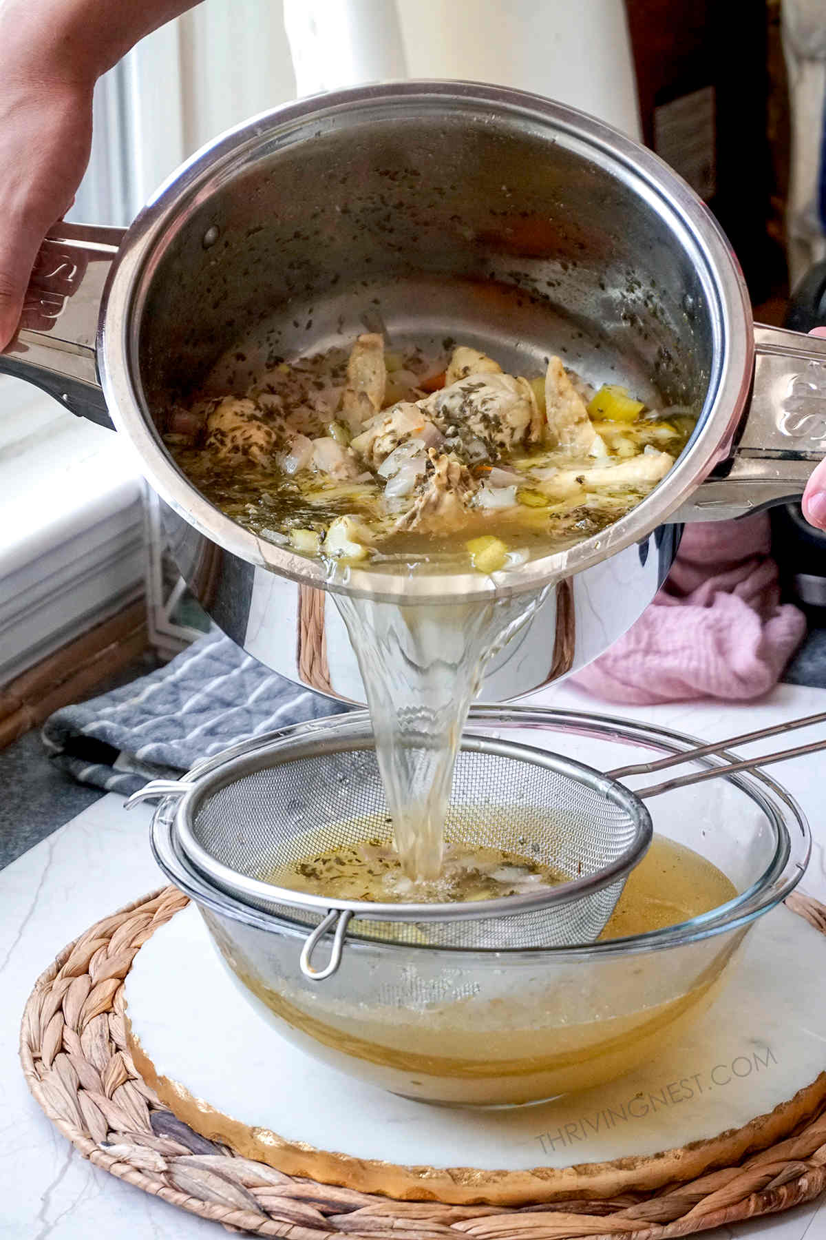Chicken stock or chicken broth strained and poured in a bowl.