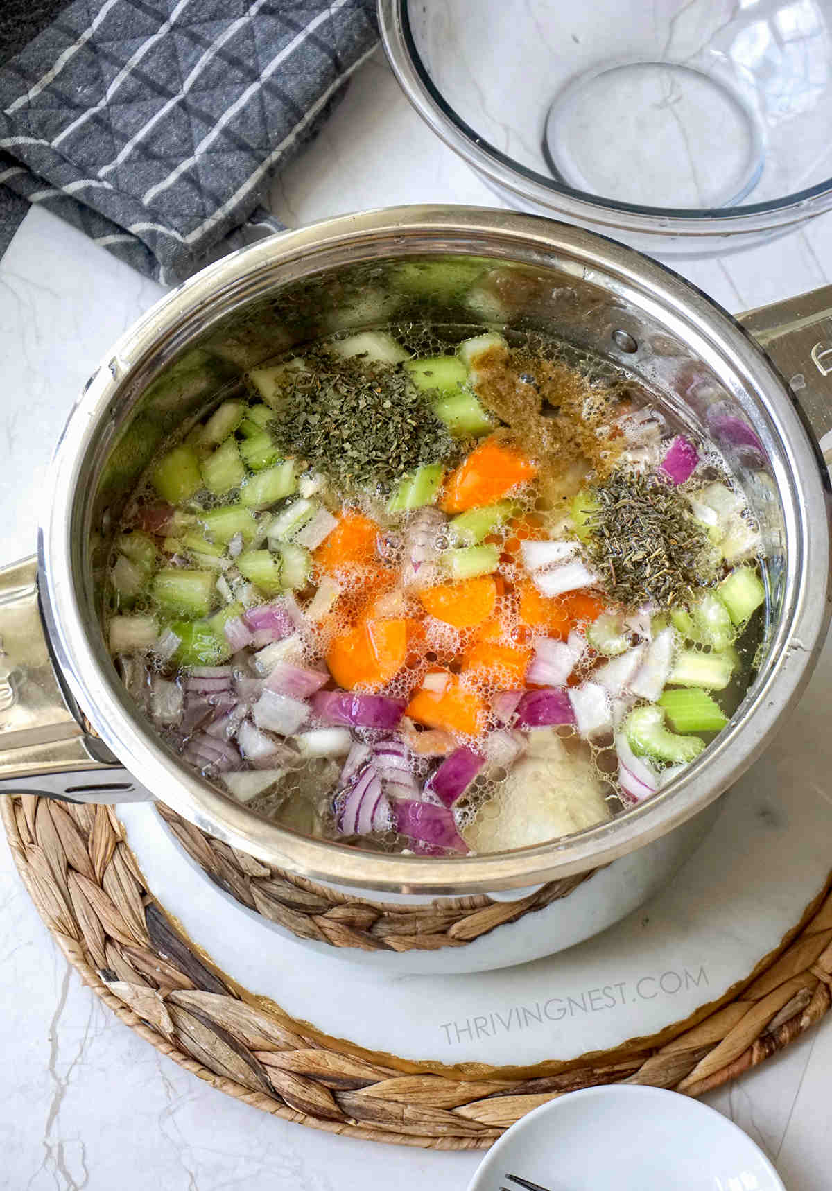 Added vegetables to the chicken stock/broth.